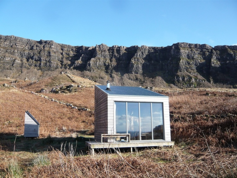 Off grid with its own PV for electricity and solar panels and wood burner for hot water